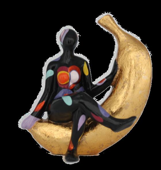 Lady Eva black sitting on Banana 12x14cm Color A